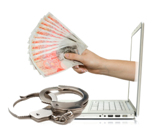handcuffs and money computer